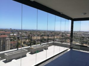 balcony renovation - frameless glass
